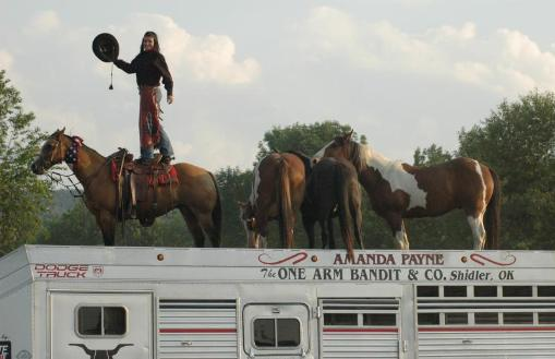 The crowd wildly applauded when Amanda Payne loaded three wild mustangs on top of her stock trailer for The One Arm Bandit & Company entertainment at the recent Junction City Rodeo.