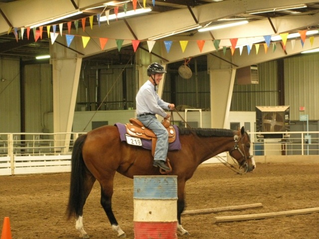 Ben Johnson of Arkansas City rides his Quarter Horse mare, Lily, in an Equestrians with Disabilities walk/jog trail class during a South Central Stock Horse Association show at the Kansas State Fairgrounds in Hutchinson.