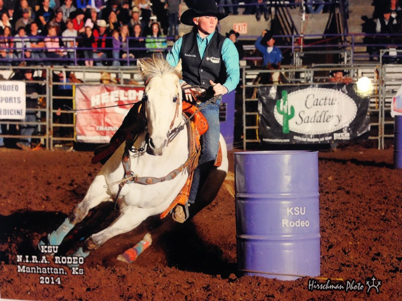Katelyn Eike, a Kansas State University sophomore studying animal science in the pre-veterinary medicine curriculum from Chatham, Illinois, is ranked among the top contestants in barrel racing standings of the Central Plains Region of the National Intercollegiate Rodeo Association. Shown on her gray mare called Pepper at last year's K-State Rodeo, the team will be in competition at the 59th annual K-State Rodeo this weekend, February 20-21-22, at Weber Arena on the KSU campus in Manhattan.