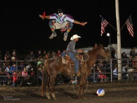 """Whether he's hopping over the fence to spoof with a spectator, diving away from a mad bull or jumping over a pickup man's horse, rodeo clown-funnyman Jason Dent, Humeston, Iowa, is always full of stories, humor and the most unpredictable antics. Known as """"Whistle-Nut"""" to rodeo enthusiasts, he'll be creating plenty of added excitement during the United Rodeo Association Finals, November 7-8-9, in Topeka. (Photo courtesy of Bob Fisher, TF Event Photography.)"""