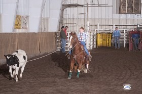 Mounted on Flaxy, Cash Fuesz, Eureka, placed third in breakaway roping with this 5.438 seconds run to be third at the 2013 Heartland Youth Rodeo Association Finals and collected the winter series champion saddle. (Photo ©Foto Cowboy.)