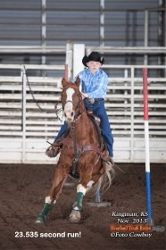 Ten-year-old cowboy Cash Fuesz, Eureka, guides his 21-year-old gelding called Flaxy through the pole bending pattern in 23.535 seconds to win fourth overall at a Heartland Youth Rodeo Association (HYRA) competition during November at Kingman. The HYRA Winter Series includes 14 rodeos in seven weekends. (Photo ©Foto Cowboy.)