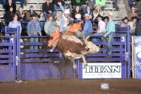 Matt May of Sydney, Arkansas, shows his championship form on a bull from Hall Rodeo LLC, Bentonville, Arkansas, during the 2014 K-State Invitational Bull Bash, sponsored by the Kansas State University Rodeo Club, recently at Manhattan. May marked 84 points on his first bull, had 85 points in the second round, to win the average, even after failing to make the buzzer on his short go-round mount. (Photo generous courtesy of FotoCowboy® Kent Kerschner/Kent Kerschner Photography.)