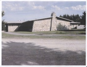 Native Flint Hills limestone facilities at White Memorial Camp include a dining hall, cabins, administration building and a director's home.