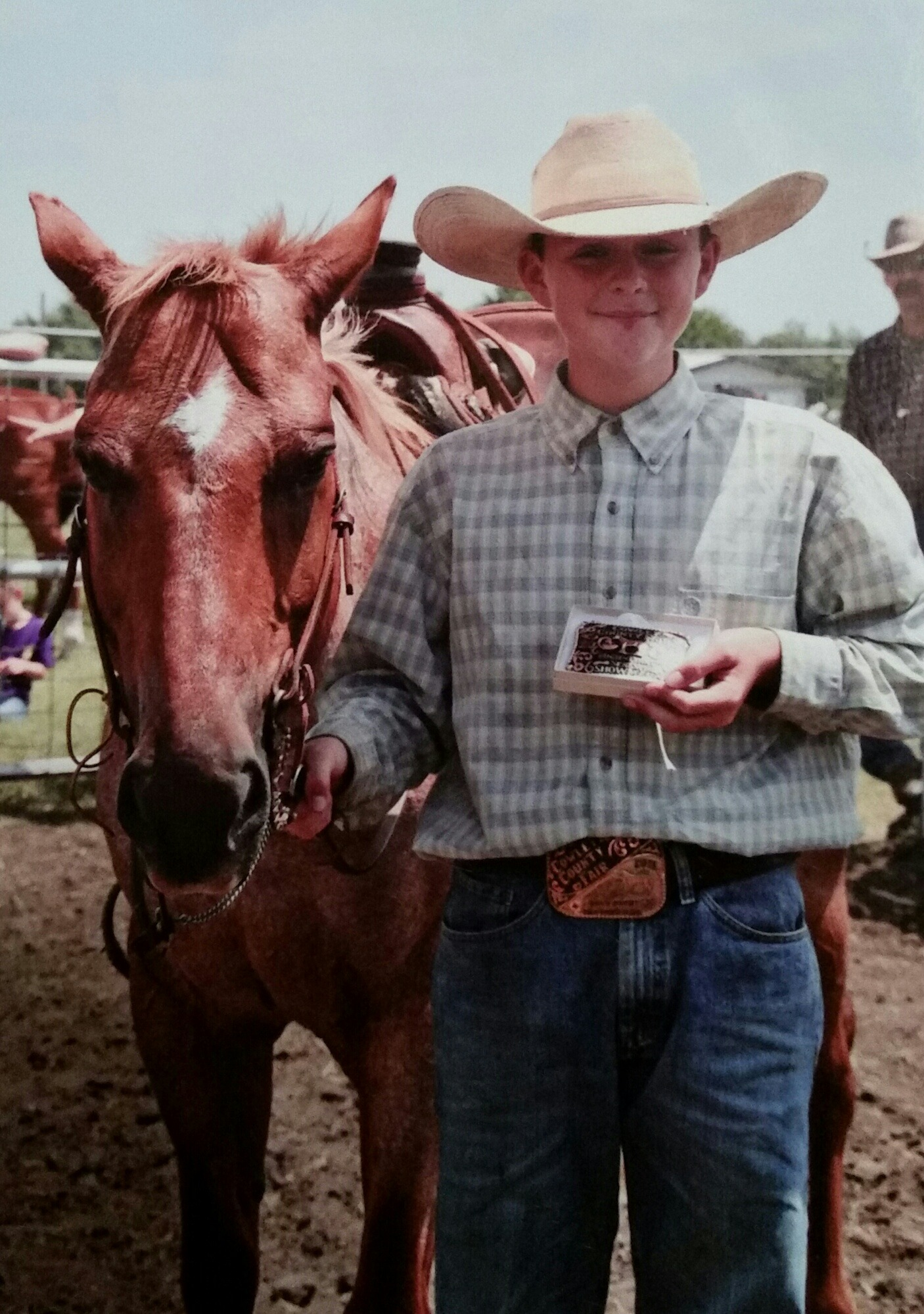 On big objective for Brayden Krepps, Cambridge,  was winning the highpoint buckle at the Cowley County 4-H Show, and he happily displayed his award after accomplishing that feat last year.