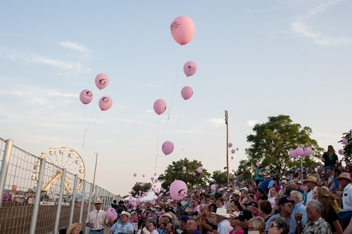 Friday, July 24, has been designated as Tough Enough to Wear Pink Night at the Kaw Valley Rodeo, starting at 8 o'clock in Manhattan, with activities to benefit the Kansas State University Johnson Center for Basic Cancer Research.