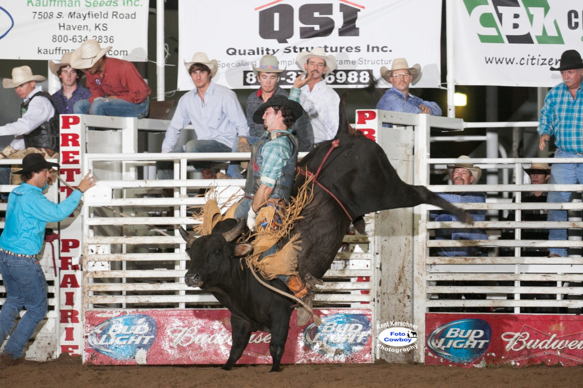 """Cody Hunsperger of Yates Center shows his championship style winning the bull riding at the Gardner Rodeo on Overstreet, an outstanding rodeo bull, with sons now in the draw at rodeos and bull ridings around the Midwest, including the Flint Hills Bull Blowout, Saturday night, Sept. 12, at Strong City. (Photo courtesy Kent Kerschner Photography- """"Foto Cowboy"""")"""