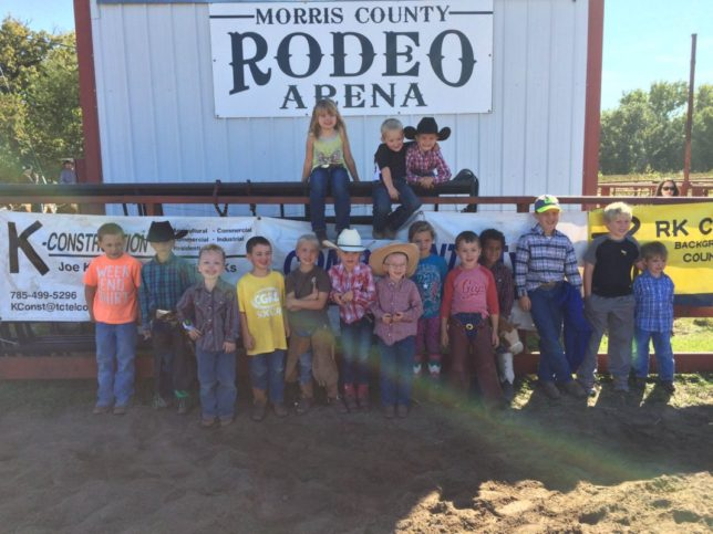 Highlight of the Sunday afternoon ranch rodeo at Council Grove was the mutton busting, actually sheep riding, for youth seven years and under, with 16 little cowboys and cowgirls trying their skills. (Photo by Lisa Wainwright.)