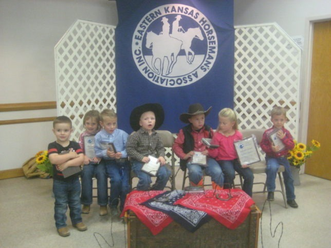 Future of the Eastern Kansas Horseman's Association is the six-and-under division participants. Enthusiast little riders collecting their yearend event awards at the presentations banquet in Clay Center were Nolan Langvardt, Shea Augustine (Highpoint), Witt Keesecker, Hudson Lange, Logan Hickey, Rowley Keesecker (Reserve Highpoint) and Layton Purdue. (Photo courtesy of Shirley McDonald.)