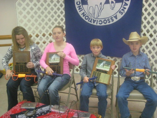 At the recent Eastern Kansas Horseman's Association (EKHA) yearend awards banquet in Clay Center, Shai Zenger and Tori Zabokrtsky received the Girl's Sportsmanship, and  Most Improved Girl Rider awards, respectively, while Tacoma Augustine and Jayden Patry, were presented the Most Improved Boy Rider, and Boy's Sportsmanship awards, respectively. The special awards are presented in memory of Rosie Clymer, who was instrumental in forming the EKHA 52 years ago, and was a longtime participant and leader. (Photo by Shirley McDonald.)