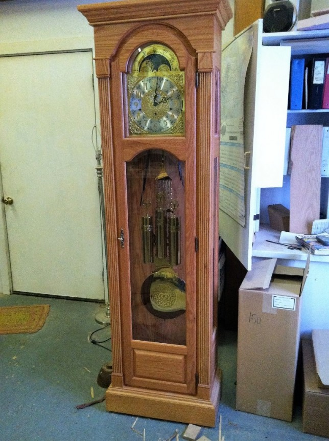 In his post-and-beam, timber frame shop, matching their farm home style, Brad Carter made this unique grandfather clock for his daughter Shana Palla.