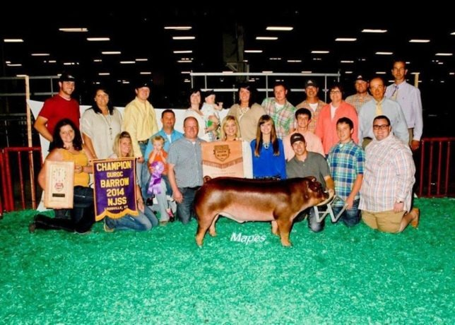Family and friends from throughout the country got in the win picture when a Duroc barrow collected awards at the Summer Type Conference in Louisville, Kentucky, as Dylan Evans, Lebo, kneeling far right, was most likely happiest of all.
