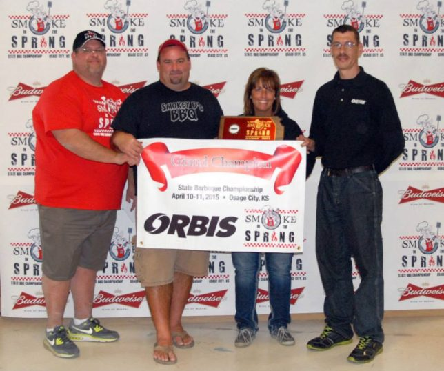 Corey Linton, director of the Osage City Parks & Recreation, is organizer for the Smoke in the Spring state championship barbecue competition and related activities Friday and Saturday, April 8-9, at Osage City, is with last year's grand champion, Iowa's Smokey D's BBQ , Des Moines, Iowa.