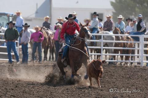 Landon Koehn, Salina cowboy, shows his championship style winning calf roping competition in the Kansas High School Rodeo Association. (Photo by Foto Cowboy.)