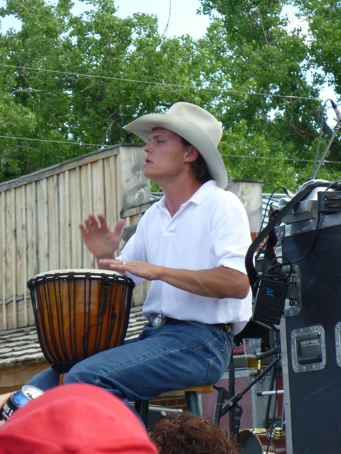 Starting out as a cowboy band drummer, Chris LeDoux plays guitar and his now lead singer for his dad's band Western Underground to be featured at the ranch rodeo, July 8, in Council Grove.