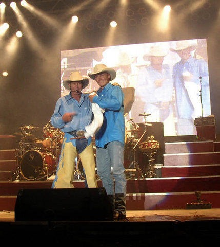 Like father, like son, Chris and Ned LeDoux performed on stage together.