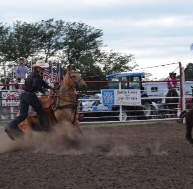 Dismounting from Scooter at the Plainville Rodeo last summer, Landon Koehn of Salina shows his championship form in calf roping.