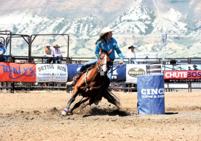 All-around cowgirl at the Kansas High School Rodeo Finals in Topeka Timber Allenbrand, Paola, shows her winning ability in breakaway roping. (Photo from TF Event Photography.)
