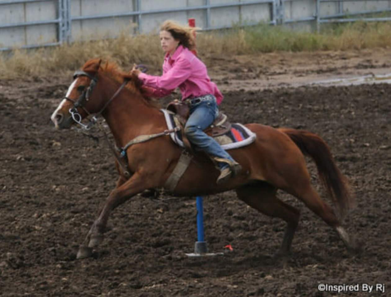 An all-around rodeo cowgirl, Shayla Dees, 13, Paola, specializes in pole bending riding her speedy Welsh mare called Little Bit. (Photo courtesy of Inspired by RJ.)