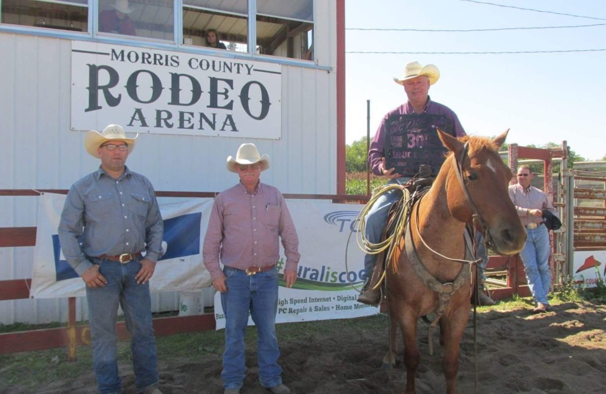 Bruce Gant, Council Grove, was honored for riding in Kansas' first ranch rodeo and every ranch rodeo sponsored by the Morris County Youth Rodeo Association (MCYRA) for 30 years. At the recent Morris County Invitational Ranch Rodeo, Clay Wilson and Jim Lee presented token recognition.