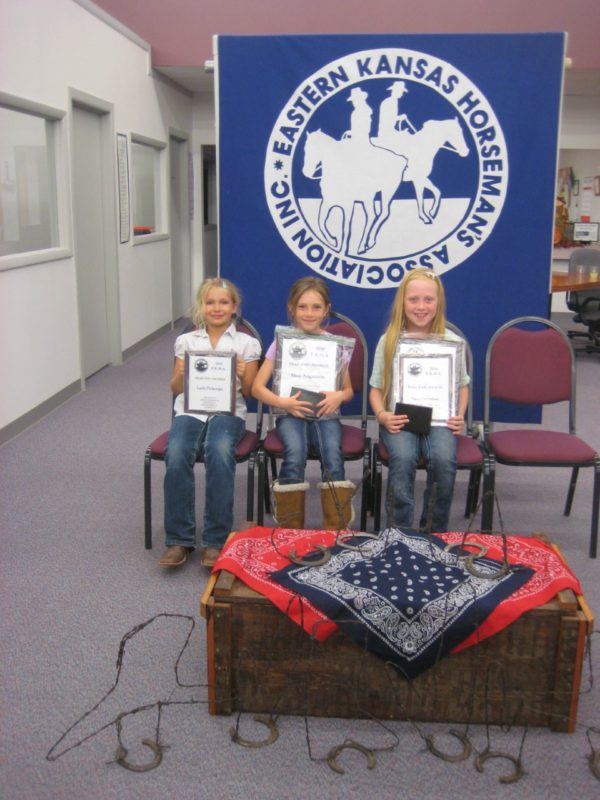 ava Gustafson (right) of the Junction City Saddle Club rode her horse Silver Hawk to be honored as the junior highpoint horse rider unit in the Eastern Kansas Horseman's Association. Silver Hawk was also awarded the Highpoint Horse Award, and Tava was the highpoint rider in the seven-to-nine-year-old division. Layla Pickerign, left, collected several yearend division placing honors, as did Shea Augustine, runner-up for highpoint in the seven-to-nine age group.  (Photo from Shirley McDonald.)