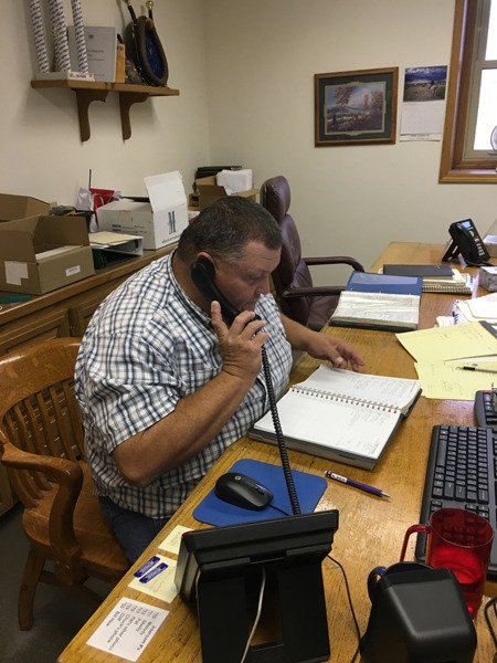 Pat Swift spends many hours a week at his Livestock Dispatch office in Cottonwood Falls lining up trucking logistics for hauling more than 540,000 cattle throughout the Midwest annually.